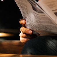 TEF man newspaper reading