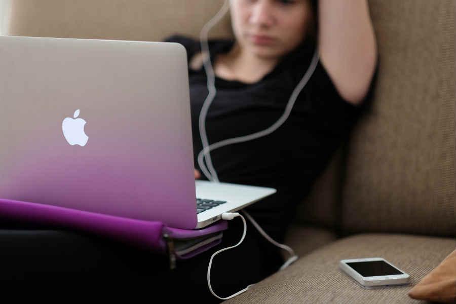 Student on Laptop on Sofa