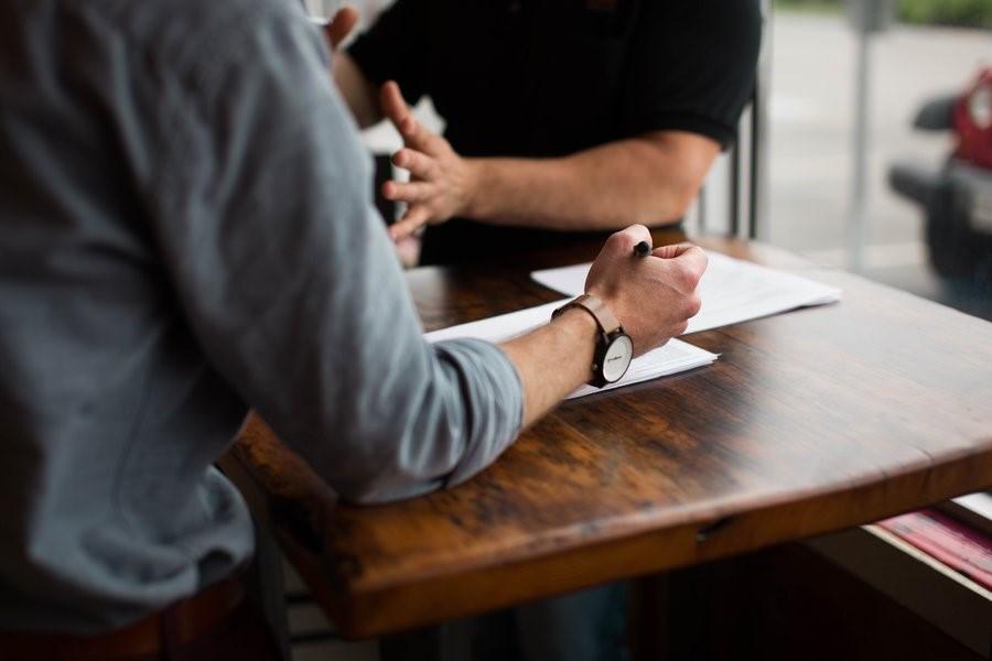 An employer and a graduate having an interview