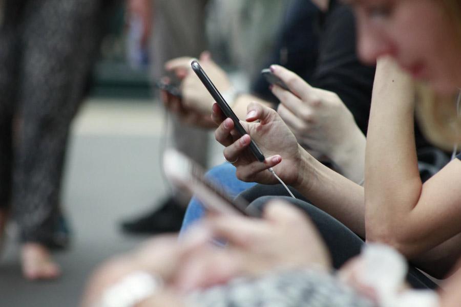 people on their phones