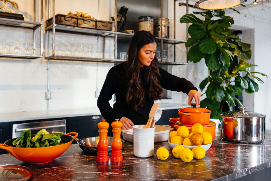 woman preparing healthy food in a kitchen